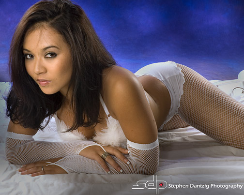 Marissa white lingerie lying down looking right