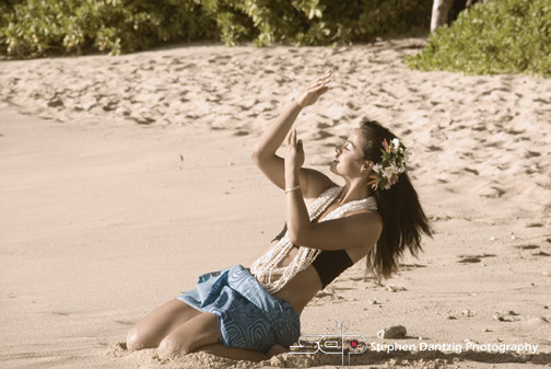 Raeceen hula on sand leaning back closer sepia